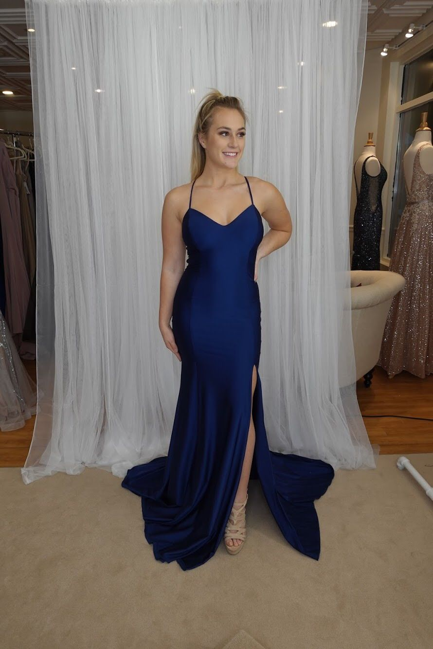 36e14e347b Atria s lace up back tight navy prom dress. Andover MA. Order online today!