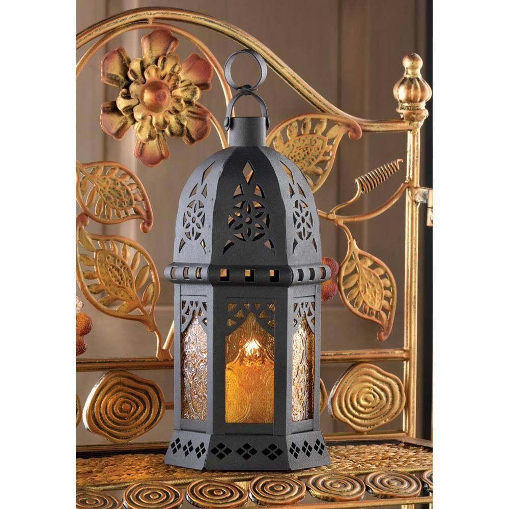 Yellow moroccan lantern candlelight takes on a dramatic air as it