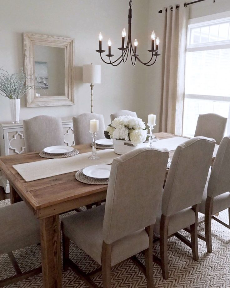 Formal dining room, Behr Paint-Ocean Pearl, custom barnwood table, Pottery Barn Ashton Non-Tufted dining chairs in Silver Taupe, farmhouse mirror by Pier 1 Imports.