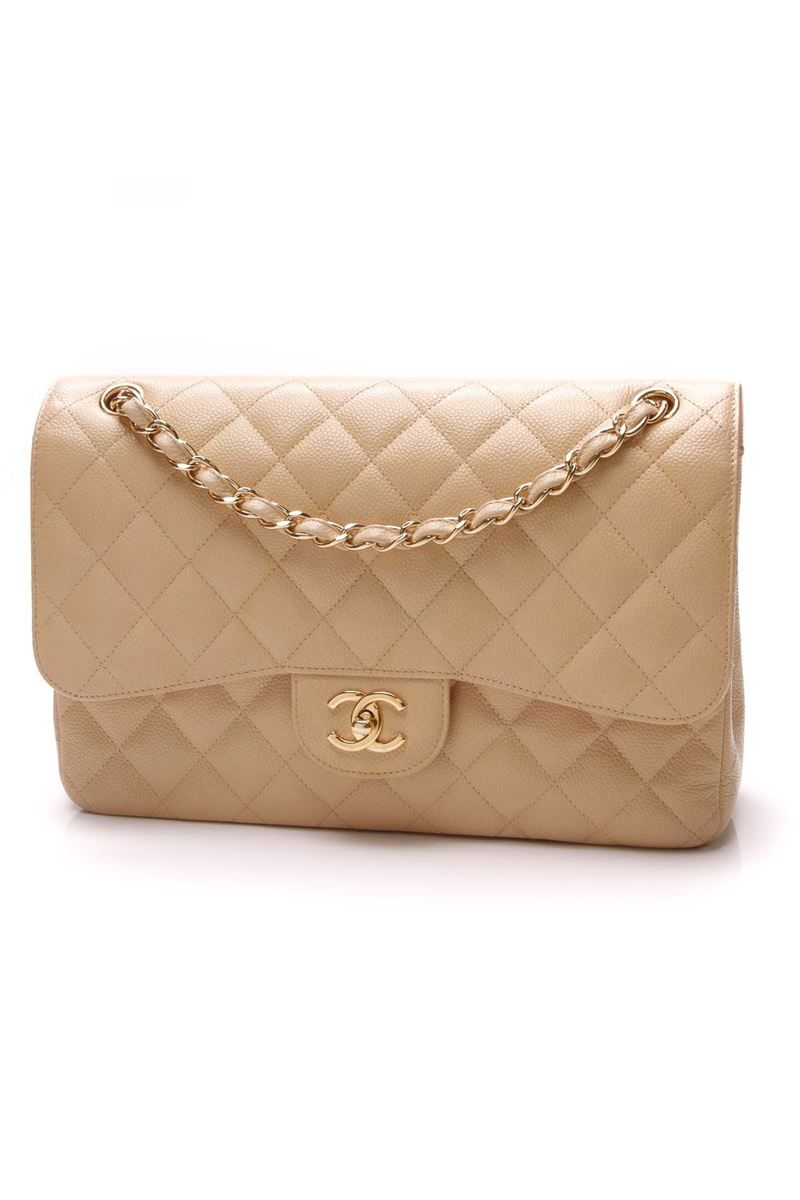 4abc876ad22614 Setting the standard for all things handbag, this authentic Chanel Beige  Caviar Jumbo Double Flap