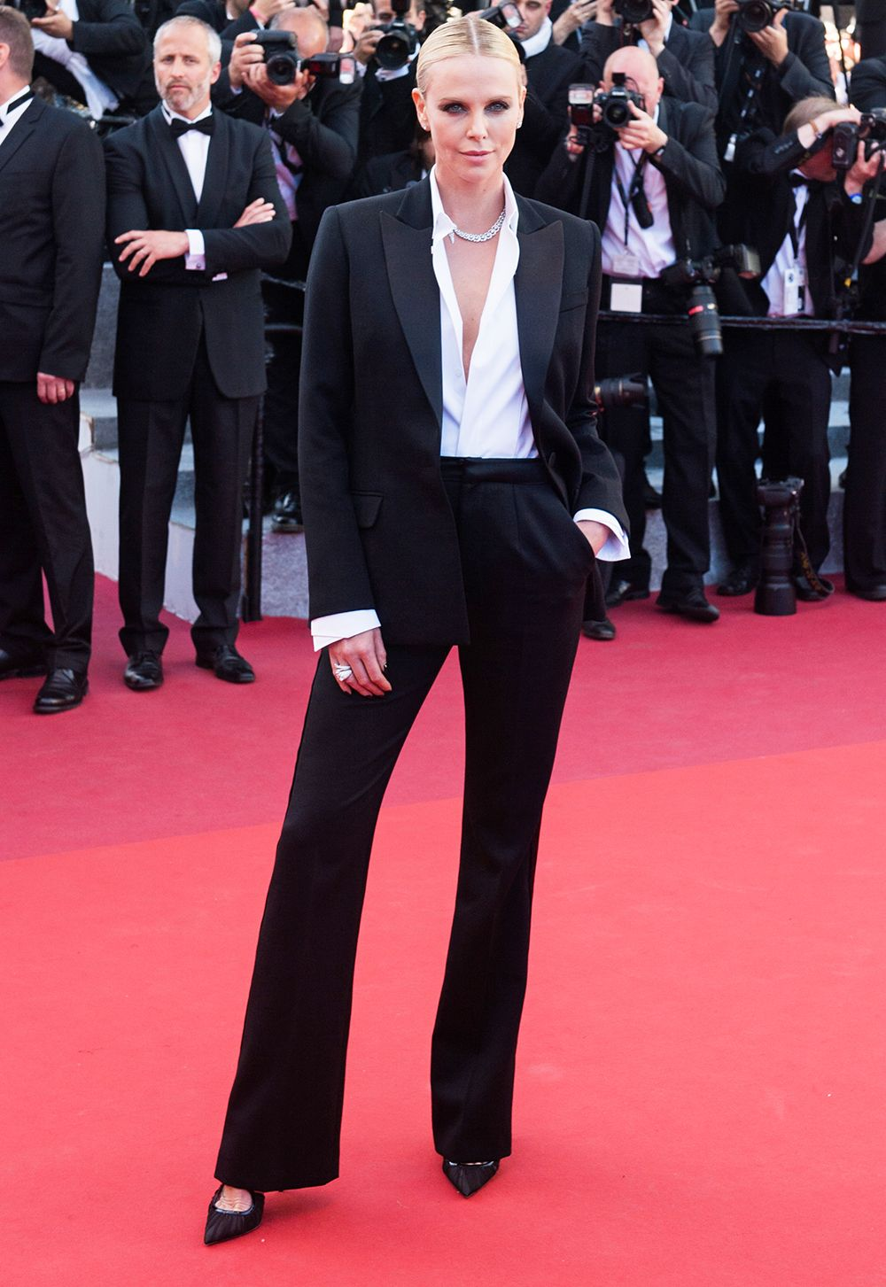 1ef568214f Charlize Theron Just Rocked a Dior Couture Tux at Cannes from InStyle.com