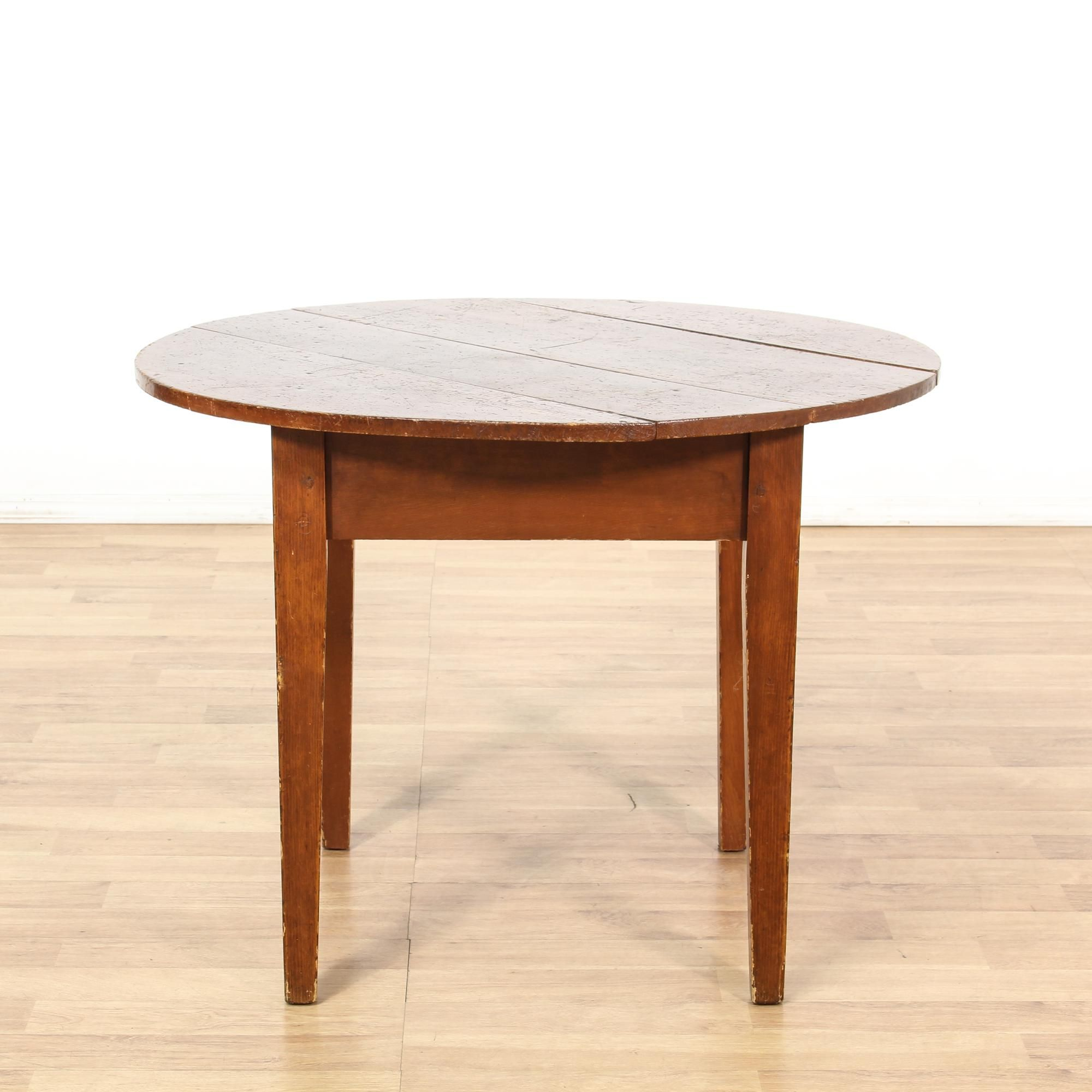 This round breakfast dining table is featured in a solid wood with