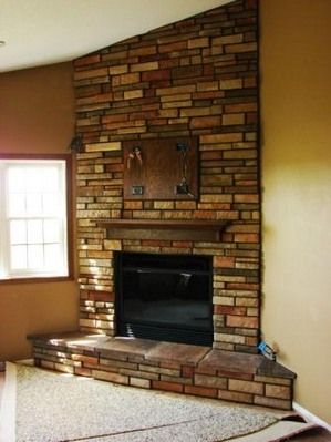 brown stacked stone faced corner fireplace