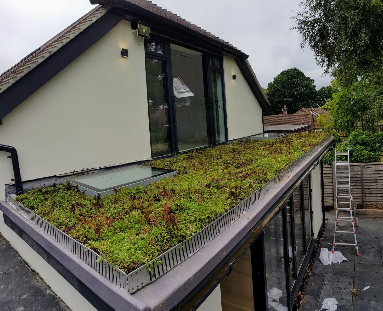 Arriving fully established and with all the necessary accessories, it only took a couple of hours for this homeowner to complete his green roof, turning something they'd try to ignore from an upstairs window into a feature they were proud to show.  #greenroofsystem #greenroofs #homeinspo #houseextension #diy #selfinstallsystem #selfinstall #homeimprovement