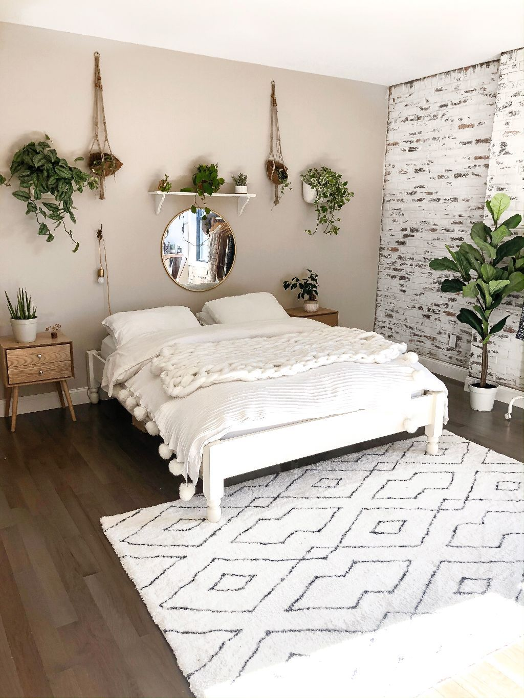Best My Boho Minimalist Bedroom Reveal White Brick Wall White Platform Bed Hanging Plants Black 400 x 300
