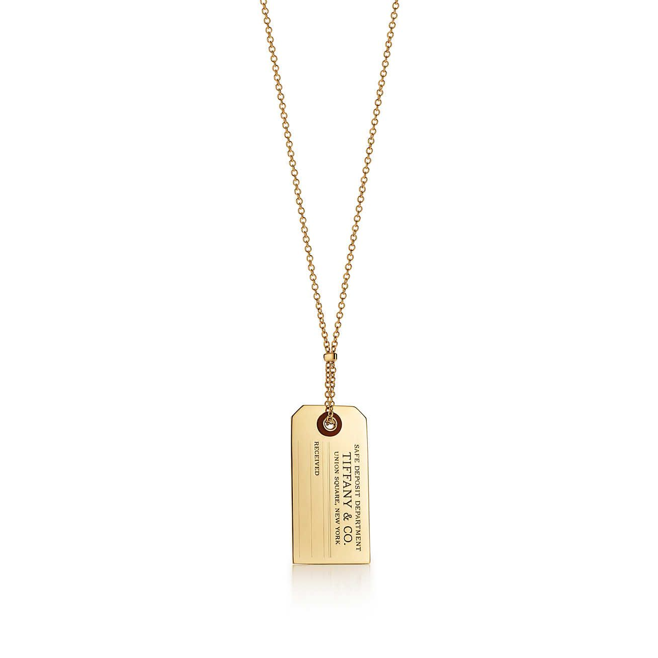 01f0973ba Tiffany Charms price tag pendant in 18k gold with carnelian, large.