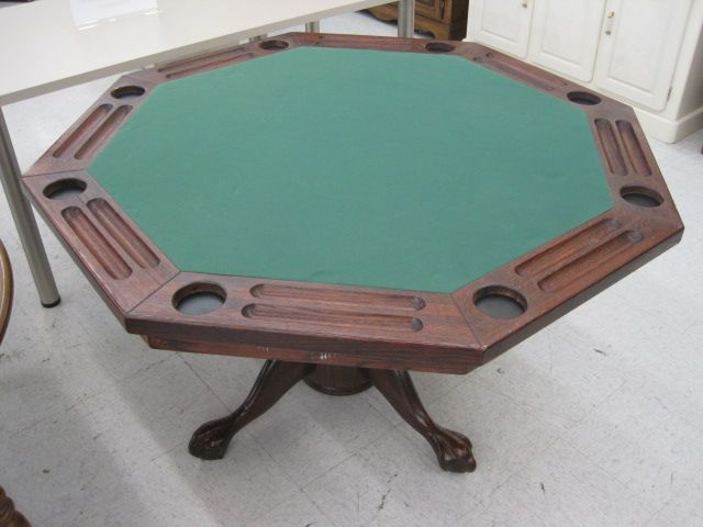 Poker Table 52 x 52 x 30 Solid red oak flip top dinette/ poker table. Poker side has green felt inlay, chip & cup holders. Pedestal base. 4 curved legs w/ claw & ball feet. Item ID: 449964 Category: Table Misc. This catalog displays some of our current inventory. All purchases must be made at the store. As hard as we try, we are subject to errors. Please be advised that we can not be held to listed prices that do not match actual prices in our inventory. SKU449964 Today's price:$ 249.99