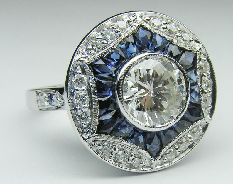 Photo of Art Deco Engagement Ring with Blue Sapphire & Diamond Halo, Forever One Round Moissanite