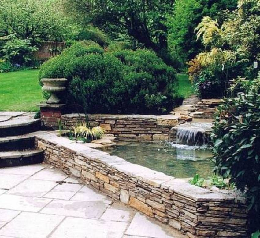 Landscaping and outdoor building raised ponds stone for Raised koi pond ideas