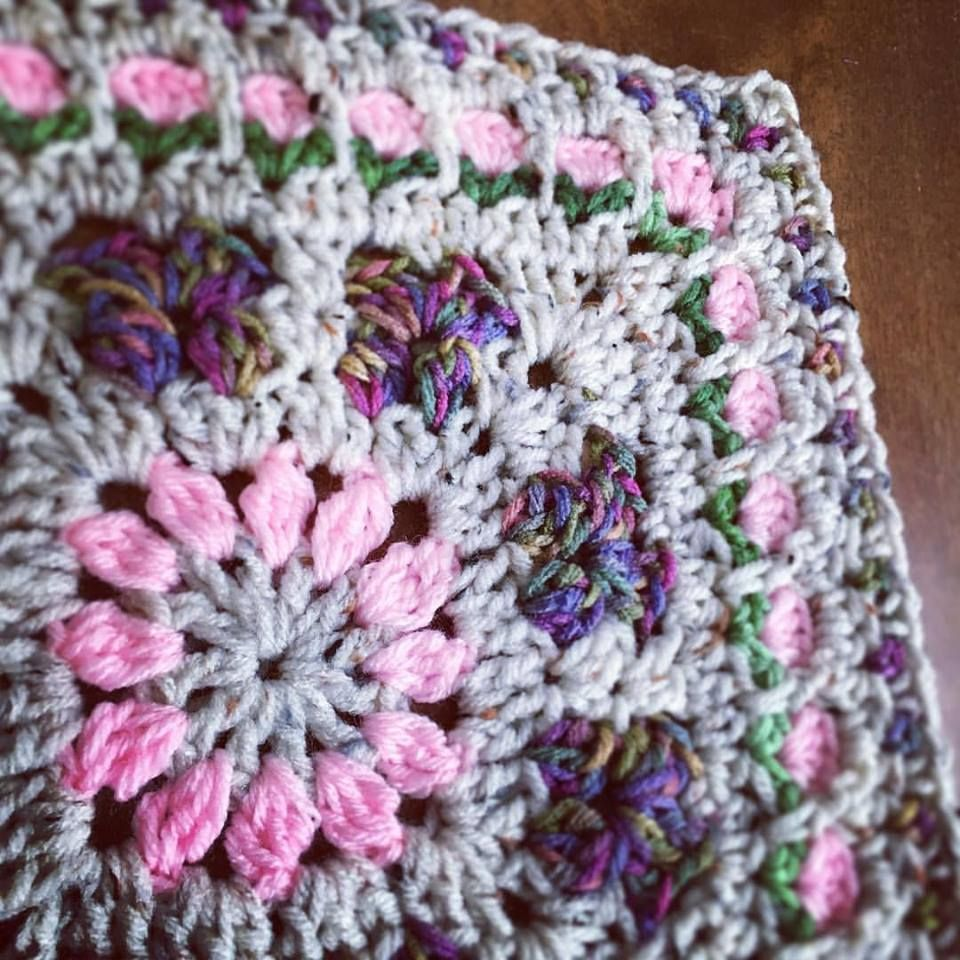 I reworked the center flower of last weeks afghan block and came up ...