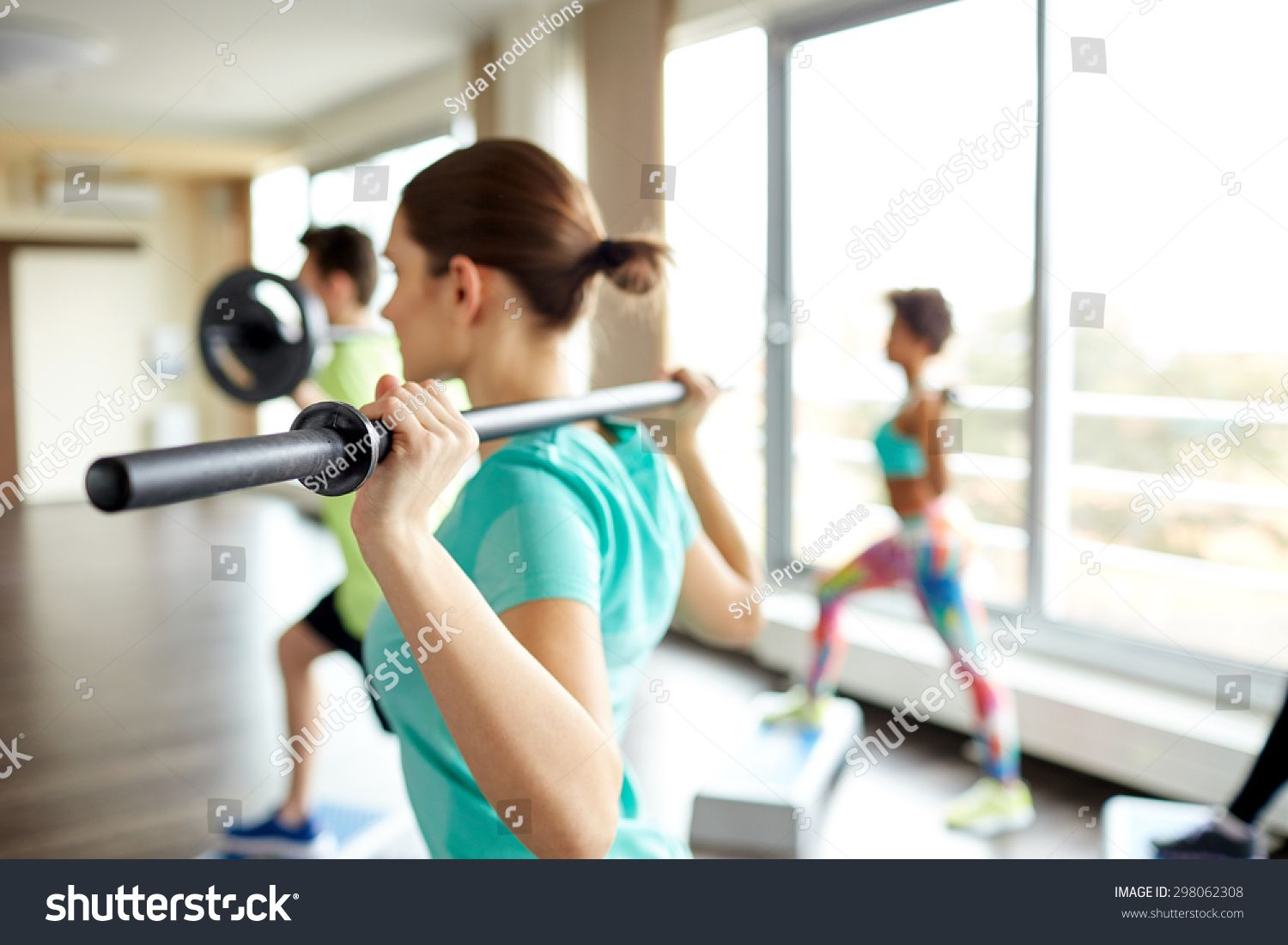 fitness, sport, people and lifestyle concept - close up of sportsmen exercising with bars and step p...