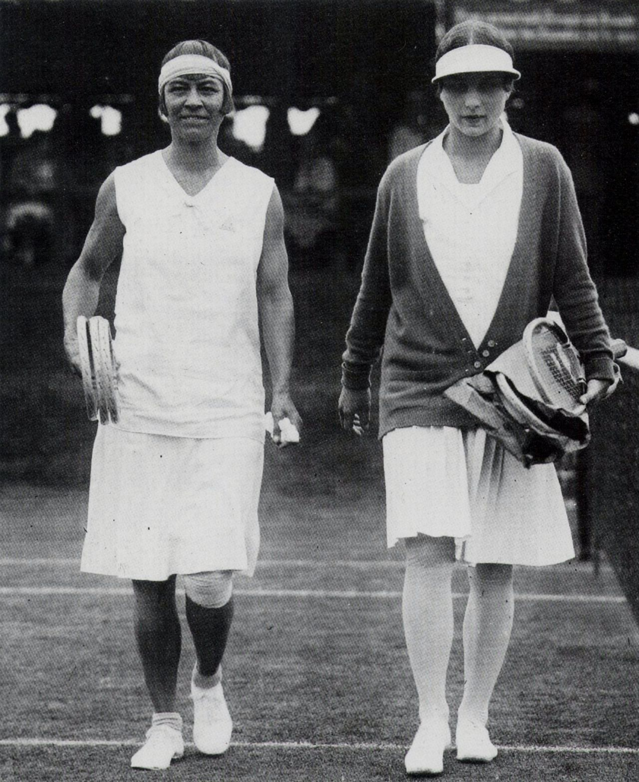 Molla Mallory and Helen Wills walk on court at the US
