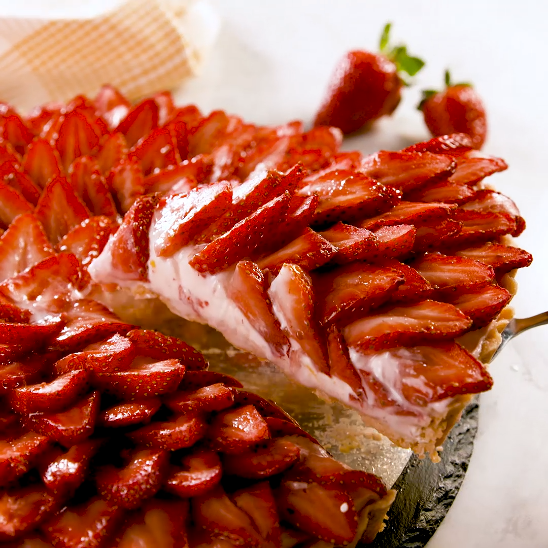 Nothing says spring quite like this easy strawberry tart. The crust is a simple no-chill version of a pie crust that we are obsessed with, ever since we used a similar version for our apple tart. The filling is a sweet cream cheese with a hint of lemon that makes the strawberries pop. We will be making it all season long! Get the recipe at Delish.com #easy #recipe #delish #bestever #strawberrytart #tart #strawberry #fruit #summerrecipe #creamcheese #dessert #Easy Recipes cookies Best-Ever Strawb