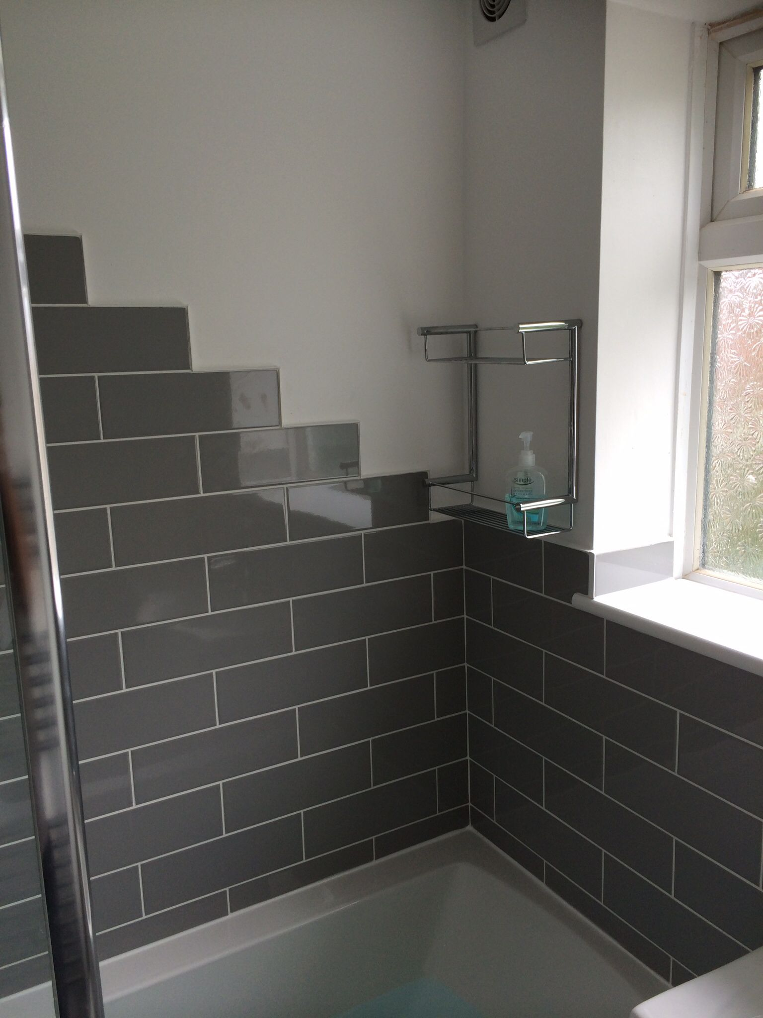 Stunning Linear Grey Brick Style Tiles From Topps Tiles Designed And Installed By Aquanero Bathroom Design In Brick Style Tiles Bathroom Design House Design