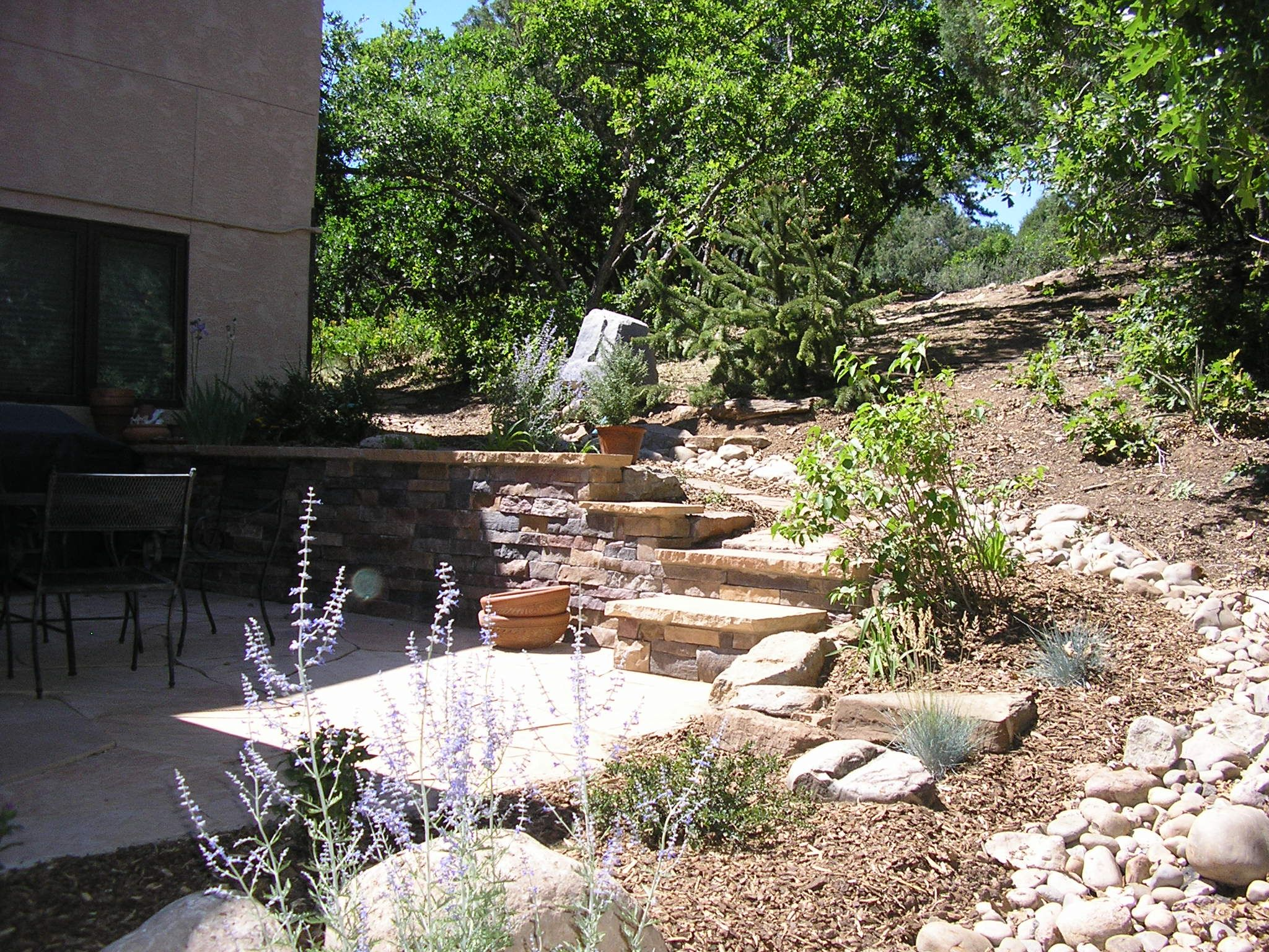 Cobblestone swale for landscaping drainage in durango for Landscape drainage design