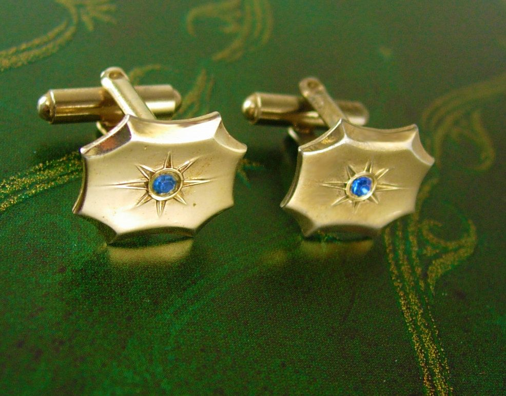 Vintage Blue Topaz Gold Filled Cufflinks Star Wedding Anniversary Valentines. This Beautiful vintage pair of Blue Topaz or Rhinestone gold filled cufflinks would be perfect for most any occasion. They are in good vintage condition and would be so nice as a gift or to wear on that special occasion including a night out on the town. They are medium weight, very good quality and well made. Some wear sold as is. Add that perfect touch of vintage to a classic suit or tuxedo. We dont polish these…