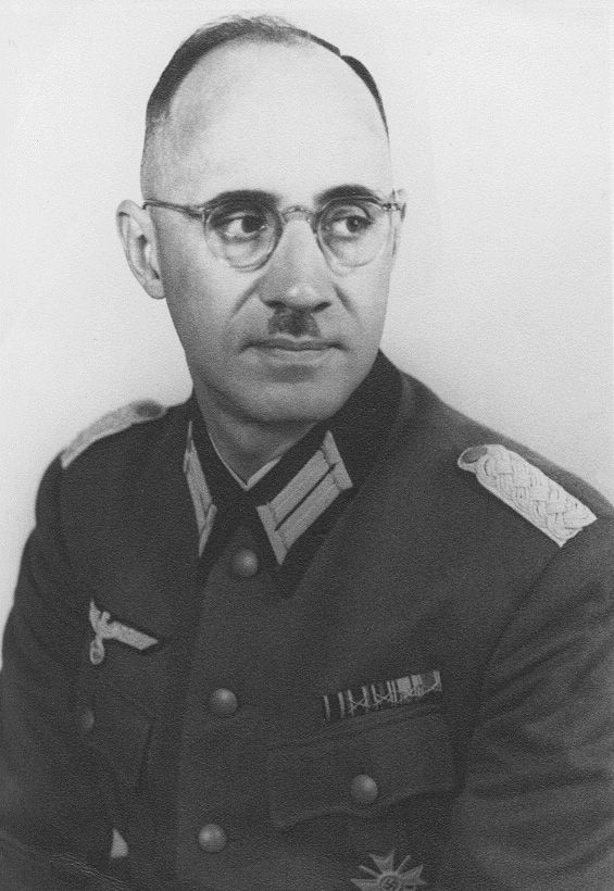 """Major Karl Plagge (1897-1957) was a German Army officer who used his position to employ and protect some 1,240 Jews at the HKP562 slave labor camp in order to give them a better chance to survive. The 250 to 300 surviving Jews from the camp constituted the largest single group of survivors of the genocide in Vilnius, Lithuania. Like Oskar Schindler, Plagge blamed himself for not having done enough. In 2005, Yad Vashem posthumously honored him with as one of the """"Righteous Among the Nations""""."""