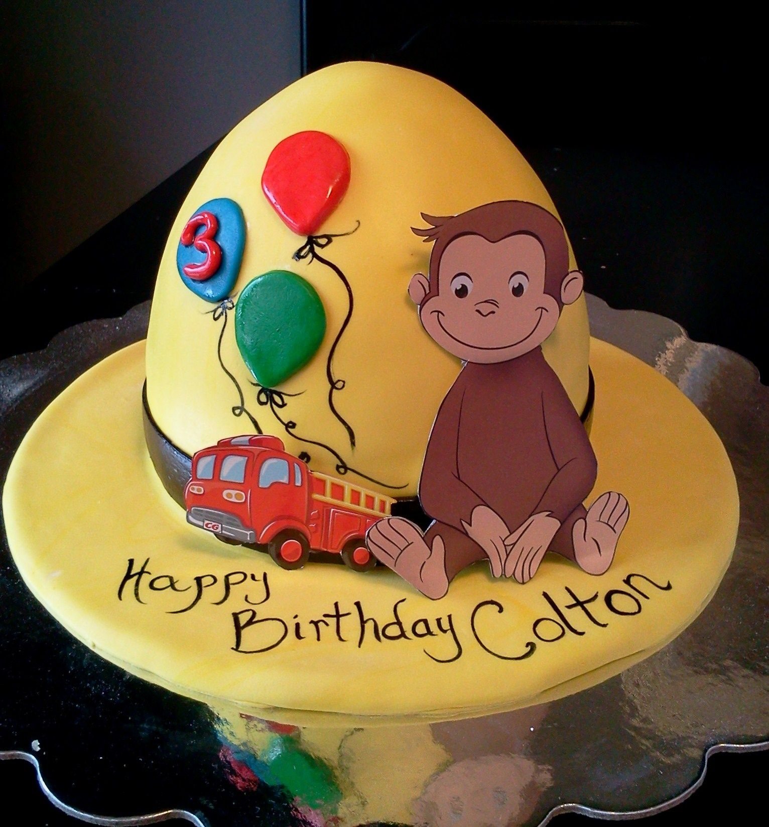 Curious George cake I created Covered with marshmallow fondant