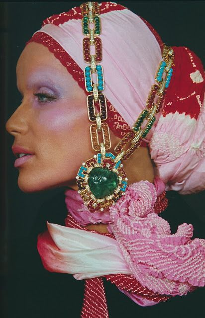 Veruschka photographed in 1970 wearing a jeweled necklace and beaded headdress.