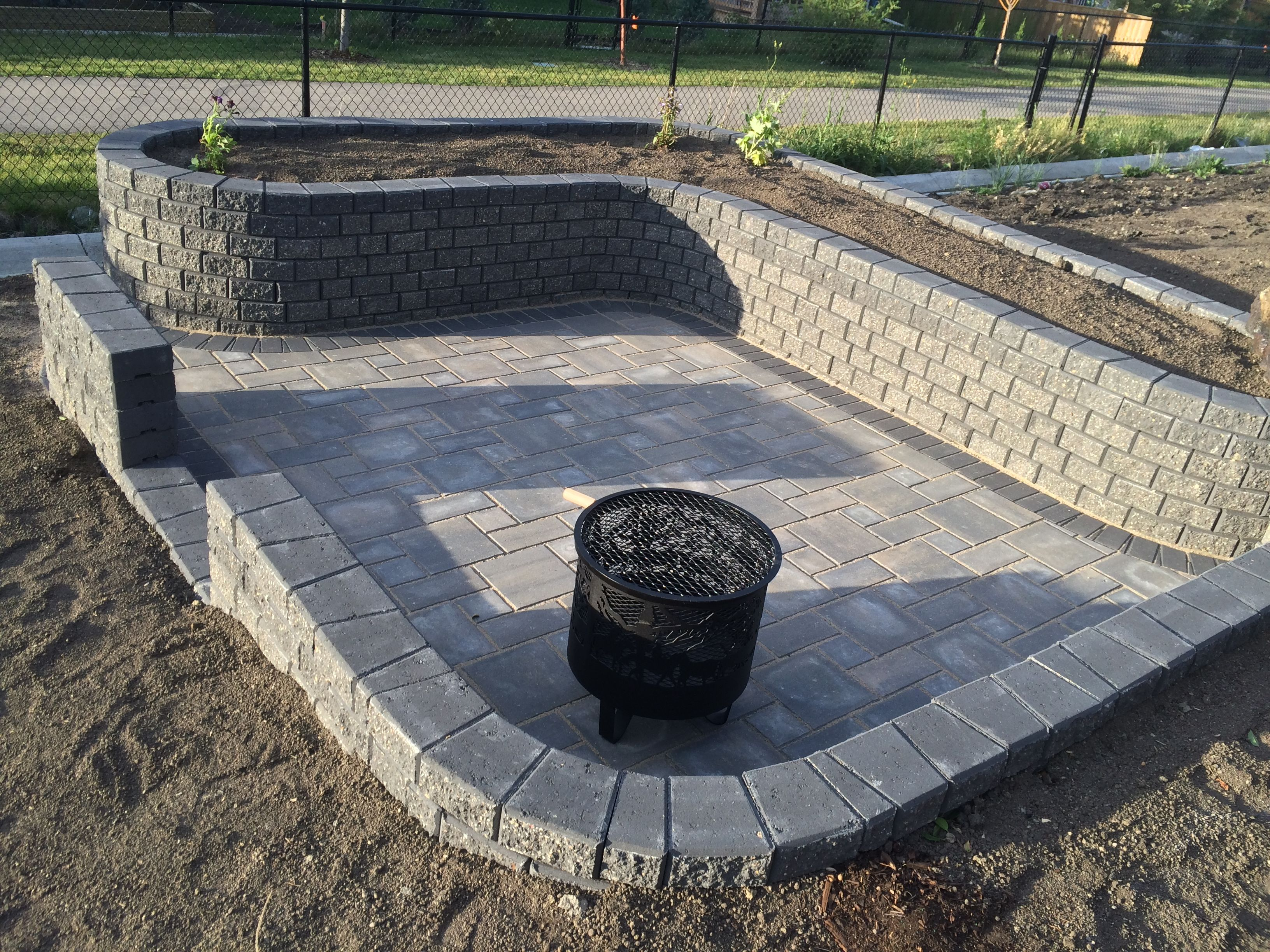 sheltered patio in sierra grey verano pavers with a charcoal