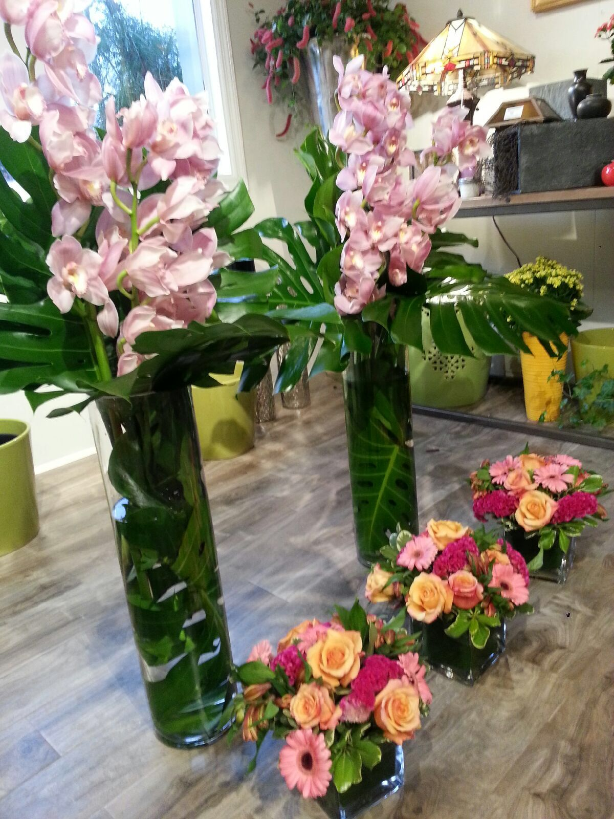 Tall cymbidium orchid vases with complimenting cube arrangements