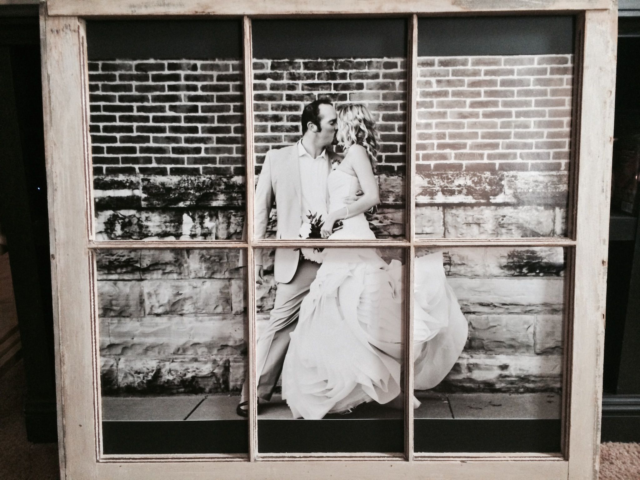 This is a large print of my little brother and his beautiful wife. I cut it into six pieces in order to fit in each frame. With the use of some mat and a point drive, this is what the finished product looks like. This was a fun project to do!