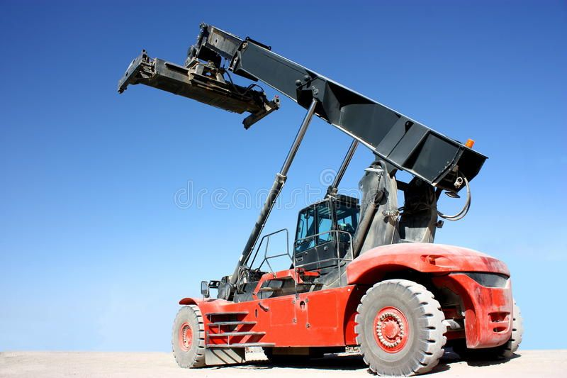 Crane A reddusty container crane vehicle isolated on blue sky background