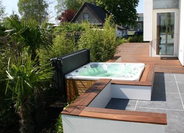 Voorbeeld van spa geintegreerd met terras omranding tuinhuizen
