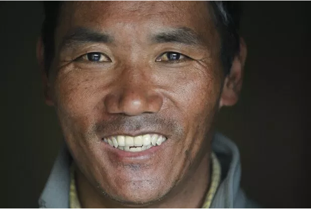 Record Mt. Everest climber returns, already planning next