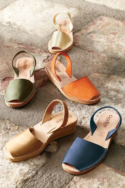 """The ideal height to elevate any outfit; the perfect colors to give it pop. A swathe of nubuck or metallic leather at the heel and toe defines this European design. Leather lining, rubber sole. 2"""" heel."""