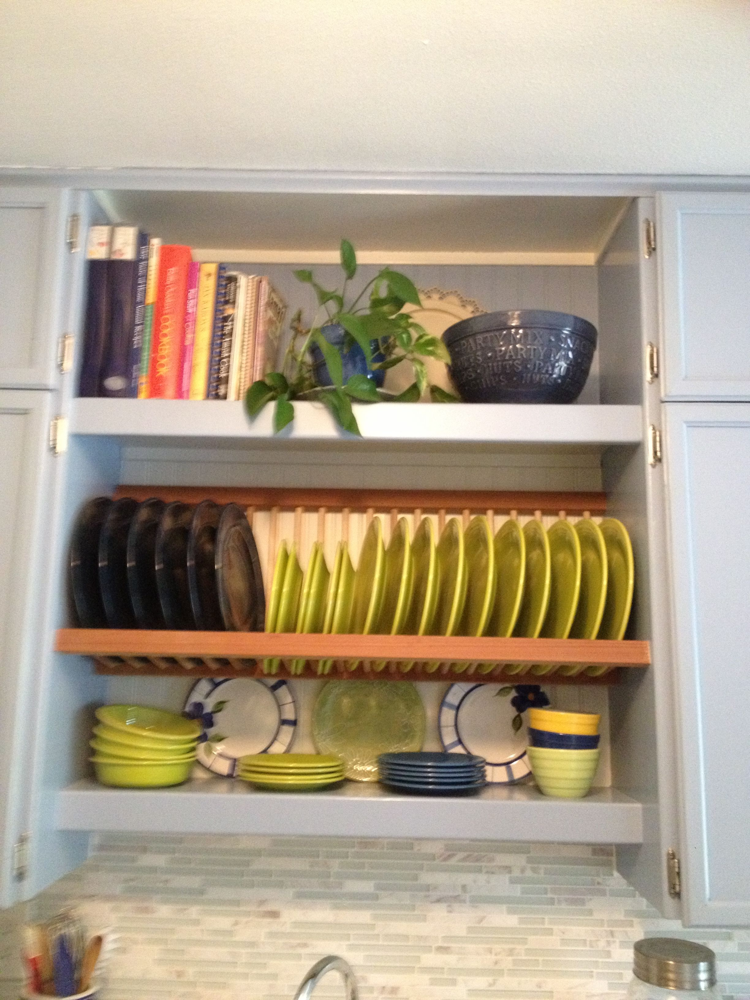 Kitchen plate rack and shelving above sink