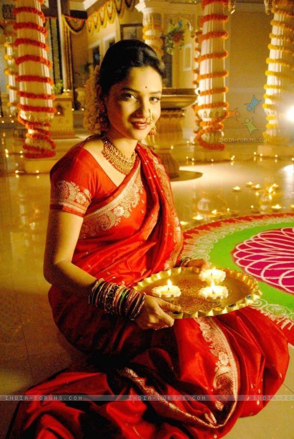 37a32e5c56 Red Saree woman in front of Rangoli Hindu Festivals, Indian Festivals,  Shubh Diwali,