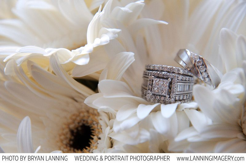 Wedding ring's on bouquet of flowers.