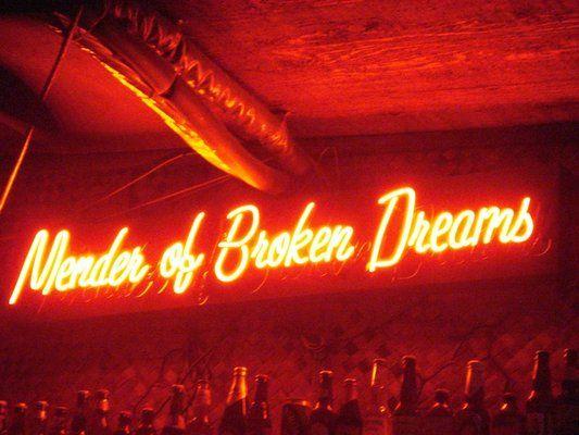 'Mender of Broken Dreams' neon sign