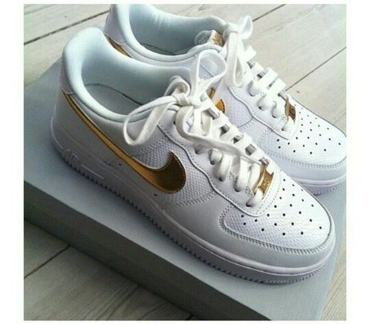 All white Air Force Ones w/ Gold metallic swoosh.