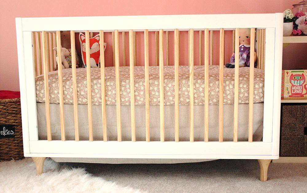 babyletto lolly crib in norau0027s coral and gold woodland nursery