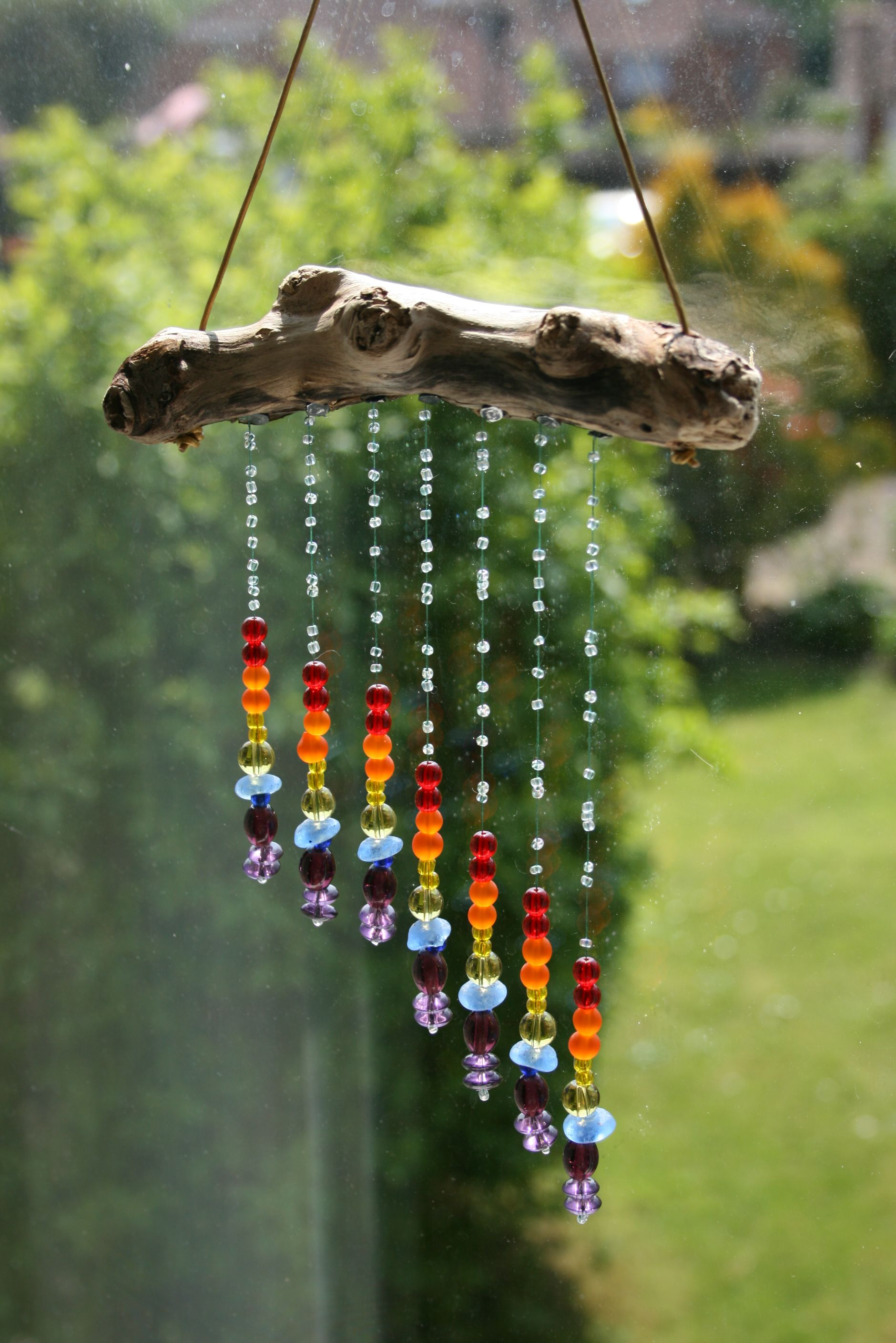 Driftwood And Glass Rainbow Sun Catcher Use Chakra Colored Beads Cks Wind Chimes Diy Wind Chimes Driftwood Crafts
