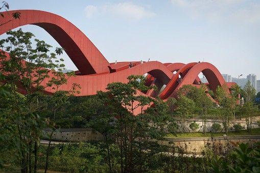 This bright red pedestrian bridge named Lucky Knot was designed by - chinesischer garten brucke