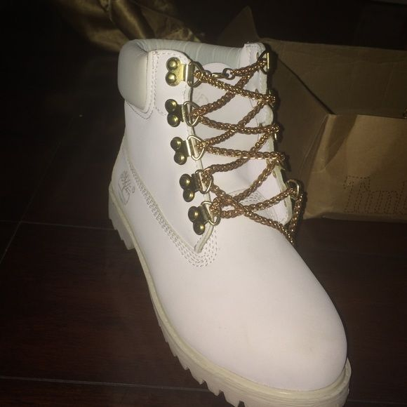 White and Gold chain Timberlands They are almost brand new