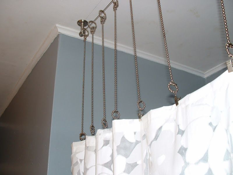 shower curtain rod with chains instead? After: Bathroom with gray ...
