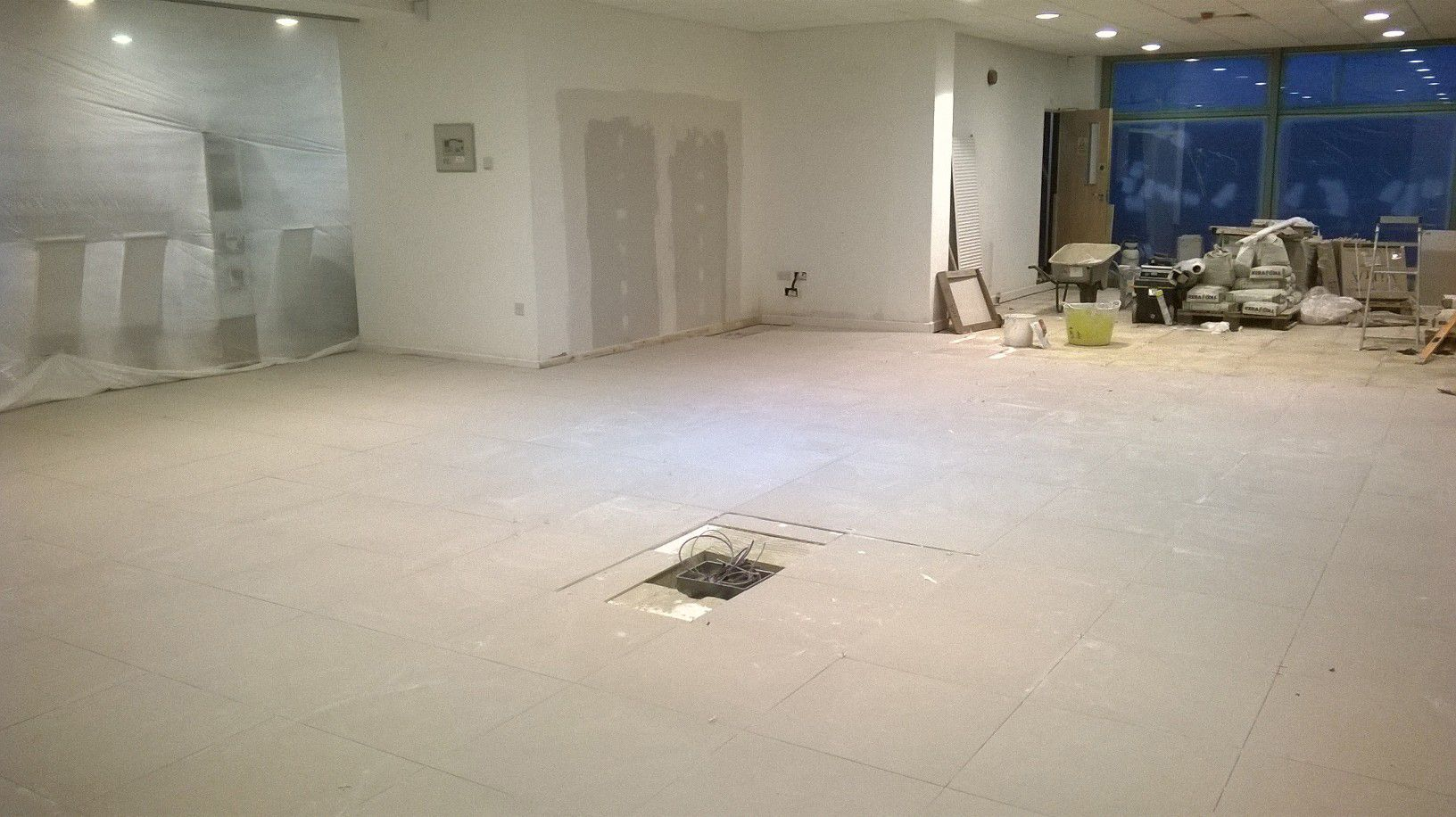 The large yeomans honda guildford showroom being tiled with large the large yeomans honda guildford showroom being tiled with large beige porcelain floor tiles by uk dailygadgetfo Images
