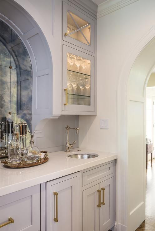 Chic Kitchen Pantry Features White Shaker Cabinets Fitted: Chic Gray Wet Bar Boasts Gray Shaker Cabinets Fitted With