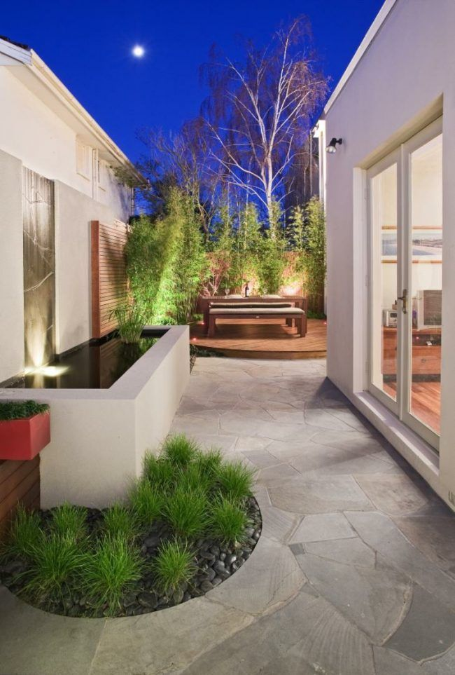 garten gestaltung stein-terrasse-kies-graeser-brunnen Garten - moderner garten mit grasern