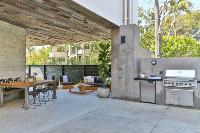 außenküche selber bauen terrasse überdachung betonwände industrieller stil esstisch eingebaute küchengeräte