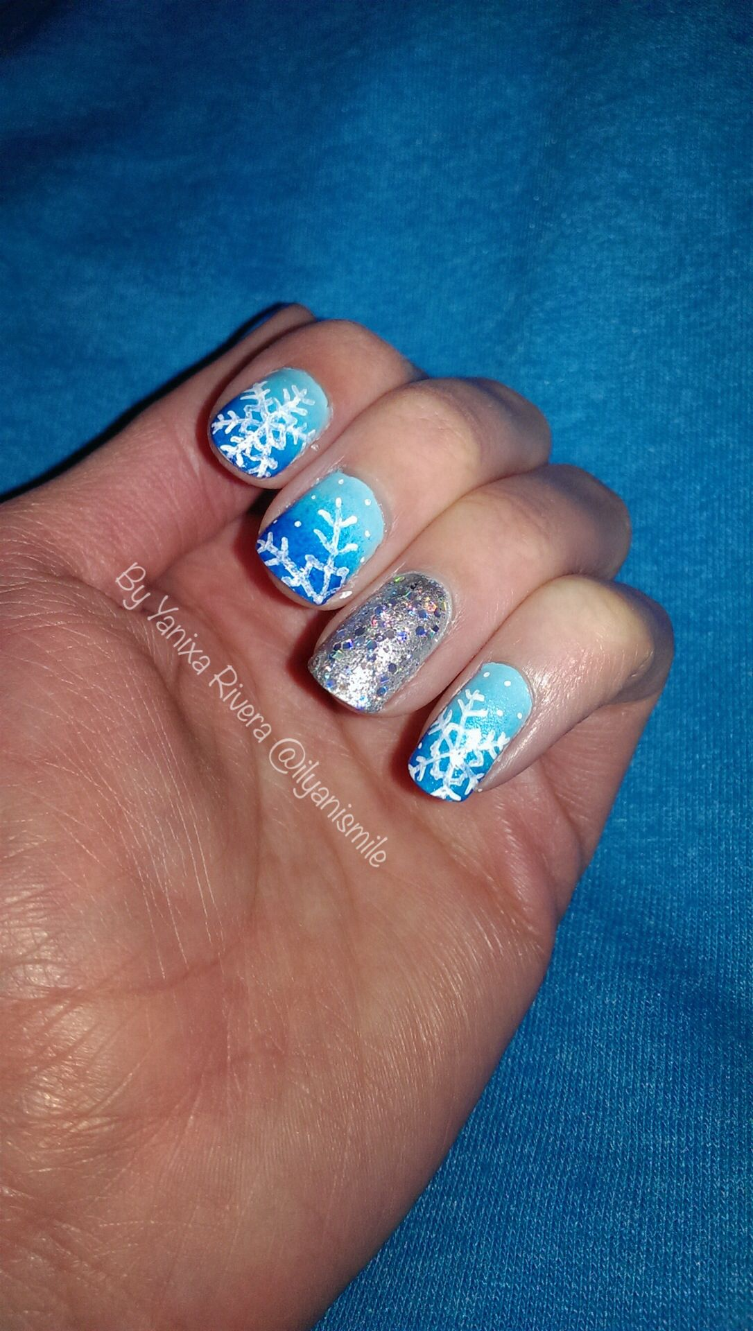 Blue ombré snowflake nails with glitter sequin accent nail. Follow me on instagram @ilyanismile also find me on YouTube.com/ilyanismile