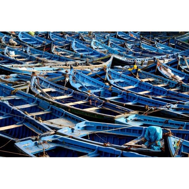"""Discovered by Kristin Rust, """"This sleepy town on the water offers up a very different Morocco. Part ancient casbah, part surfers' paradise, you'll just as easily hear the Muslim call to prayer as you will Bob Marley coming from a store front. Begin your day at the port and fish market where fishermen bring in their daily haul among beautiful blue boats..."""" at Port D'essaouira, Essaouira, Morocco"""