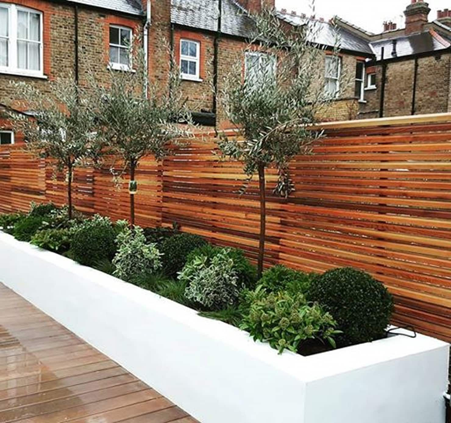 Small garden fence Raised flower beds and ever greens by