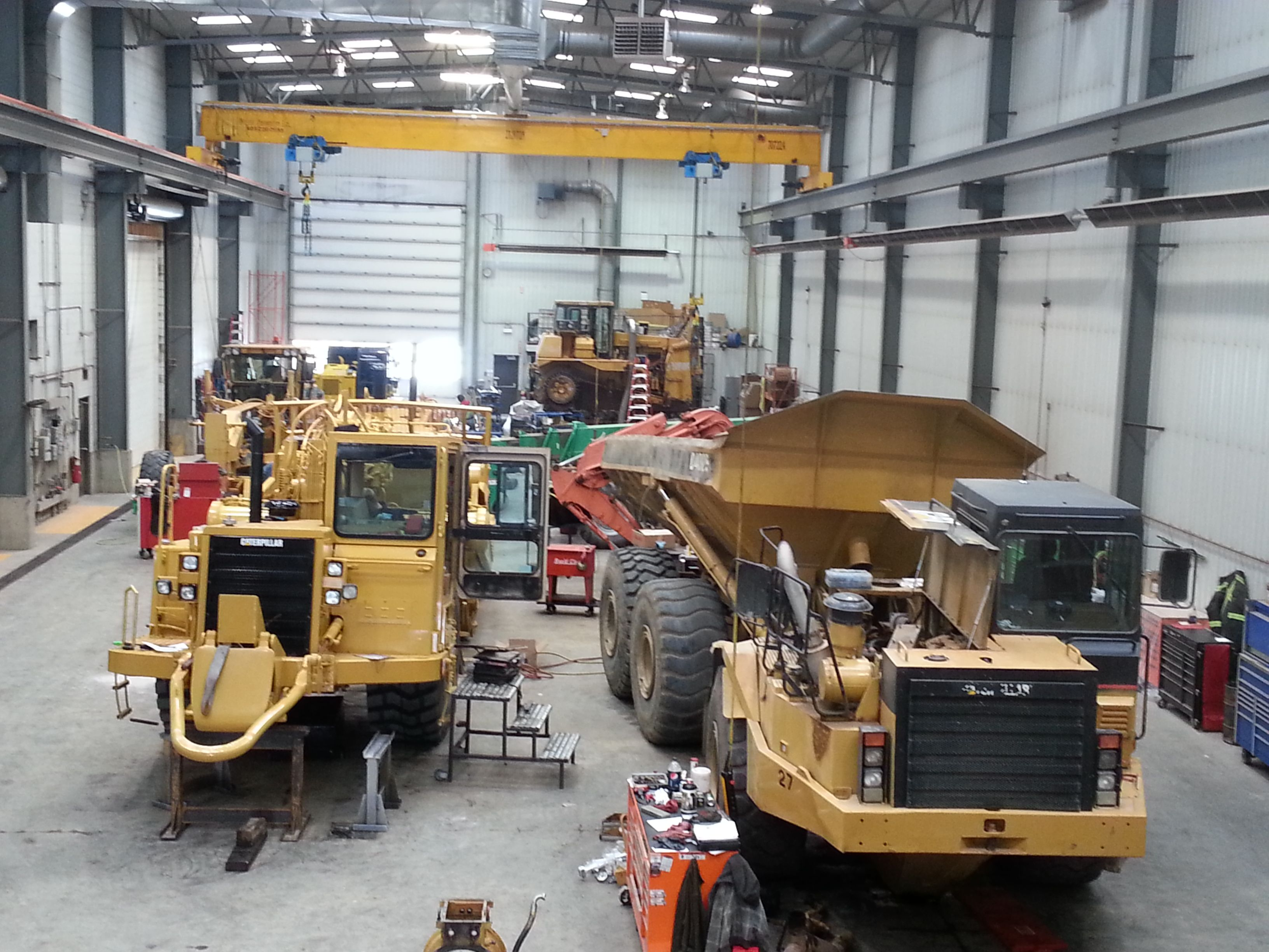 Some heavy equipment in the shop for repairs. Heavy