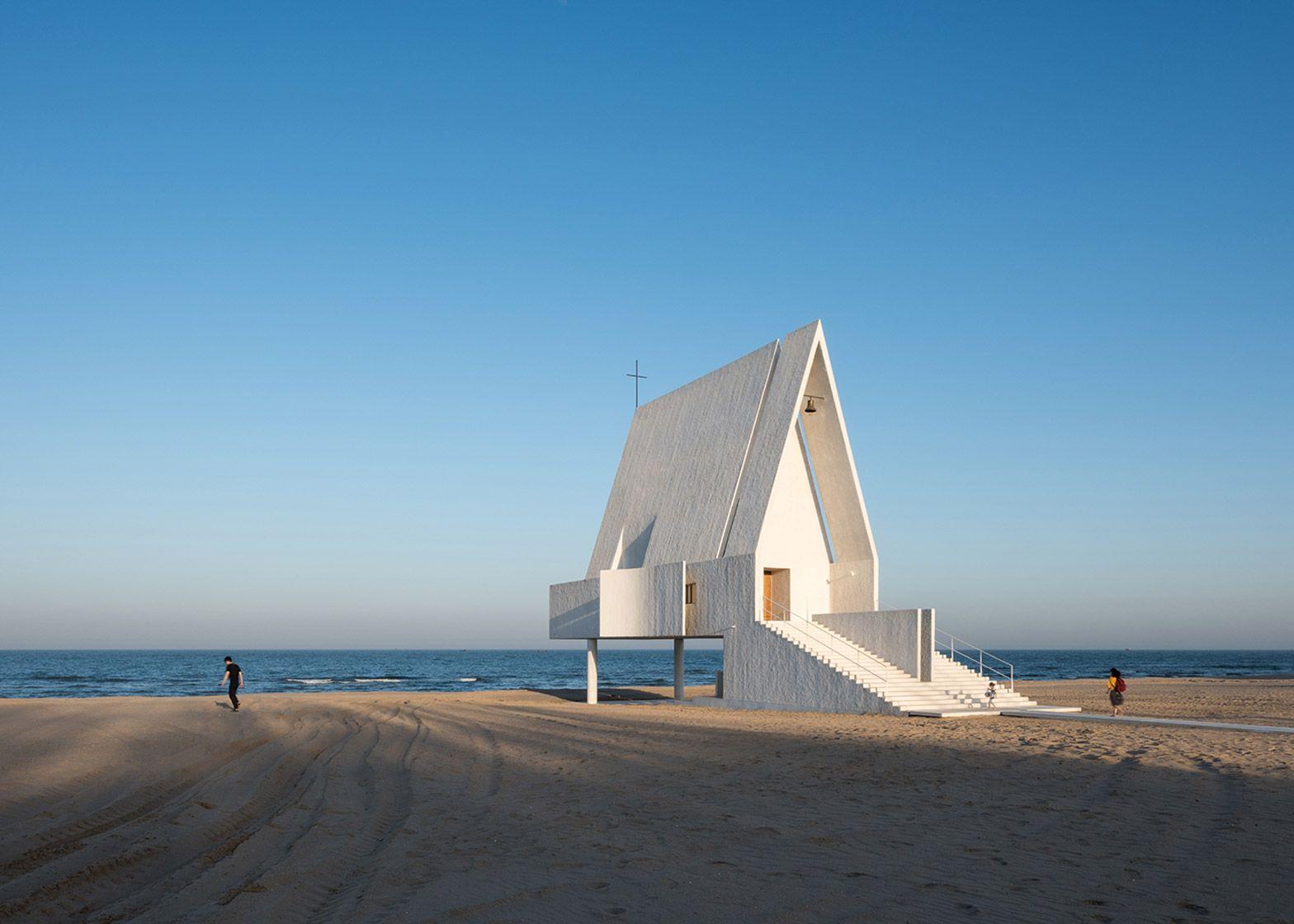 Tidal waters wash underneath Vector Architects' Seashore Chapel