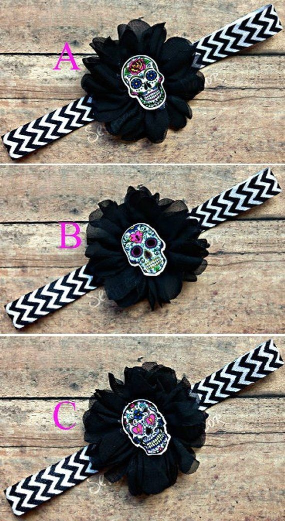This Sugar Skull Headband Is Made With Black & White Chevron Elastic, A 2.5in Black Ballerina Flower And Is Finished Off With Your Choice Of A 1.25in Sugar Skull Resin Center. Skull Option: A) Pink Rose Skull - White Background B) Heart Lock Skull - Pale Blue Background C) Purple